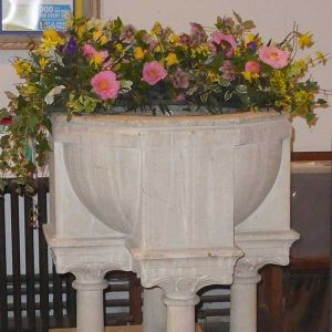 All Saints, Grayswood - font with flowers